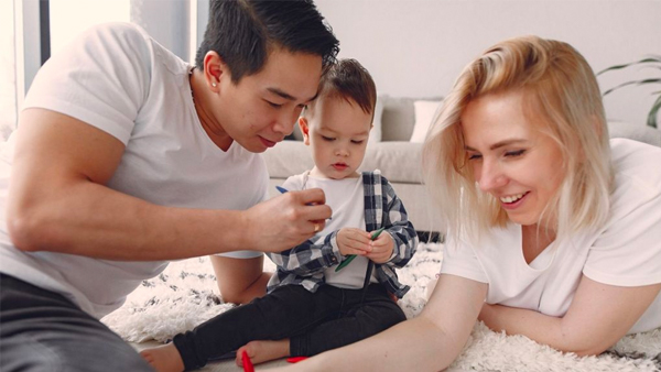 A family enjoying crafts with their young child